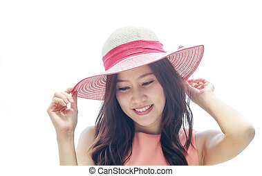 Asian woman wearing pink straw hat with expression of happy...