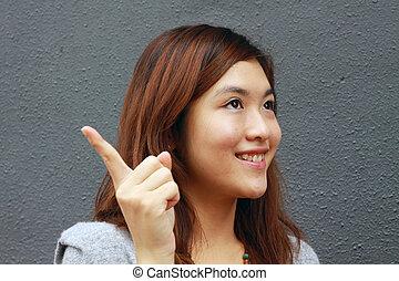 Asian woman with an idea