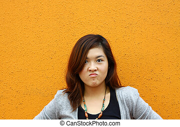 Asian woman with angry face