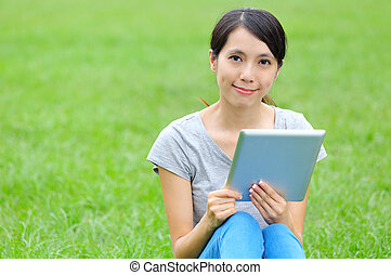 Asian woman with digital tablet