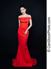 Asian woman with fashion makeup in luxury red dress.