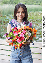 asian woman with flower bouquet in hand