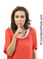 Asian woman with her fingers over lips.