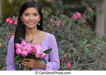 Asian woman with lotus flowers