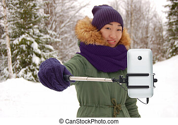 Asian woman with selfie stick