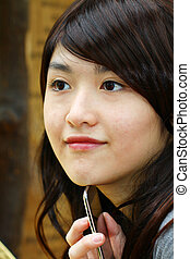 Asian woman with smart phone