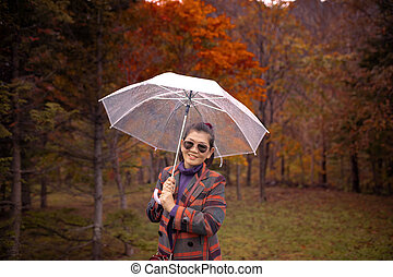 dc7612830a8df asian woman with smiling face and rain umbrella standing in red autumn  leaves hokkaido japan