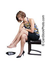 Asian Woman with Sore Feet - A beautiful young Asian...
