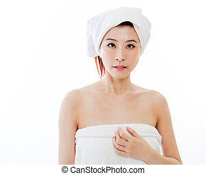 Asian woman with towel on head