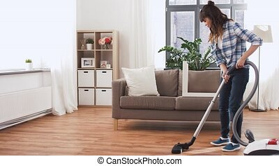 asian woman with vacuum cleaner at home - household,...