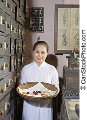 Asian woman working at traditional pharmacy