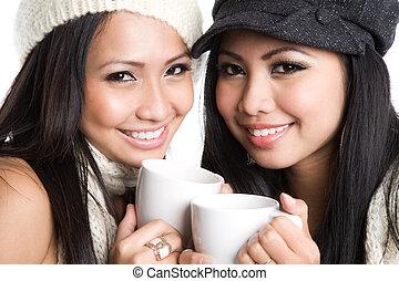 Asian women drinking coffee - Two beautiful asian women...