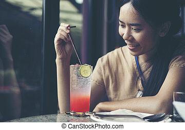 Asian women in cafe, vintage filter image