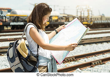 Asian women looking a map for traveling by train.