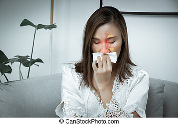 Asian women wear white nightgown & long sleeve satin robe with floral lace feeling sinusitis at night. A girl suffers from sinus in the living room.