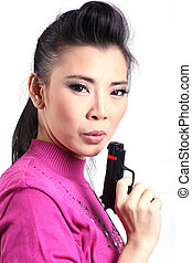 Asian womn woman holding a gun
