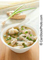 Asian wonton soup - Wonton soup with spoon in a bowl....
