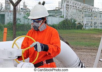 asian worker opens a latch