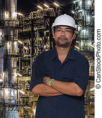 Asian worker with oil refinery plant and pipe line