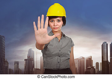 Asian worker woman with stop hand sign