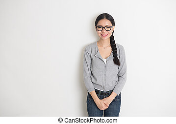 asian young female smiling with plain background