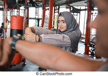 Asian young fitness muslim woman hijab streching