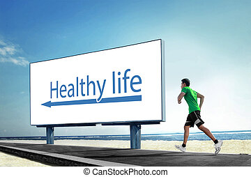Asian young man running on beach, Sport concept with a big billboard