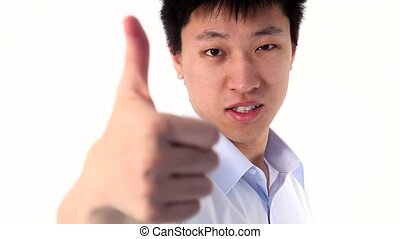 Asian young man showing thumb up