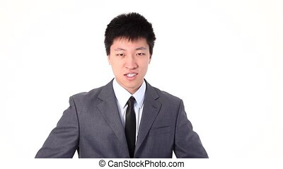 Asian young man showing thumbs up,
