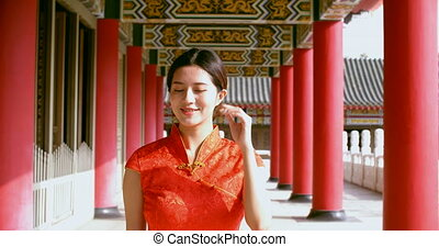 Asian young woman in old traditional Chinese dresses in the Temple