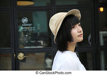 Asian young woman portrait with coffeeshop