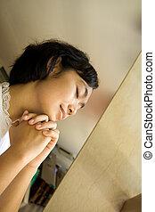 asian young woman pray in church