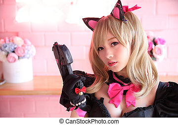 Asian young woman with game costume dress in pink background