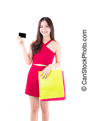 Asian young woman with red dress holding a credit card and bag paper colorful isolated on white background.