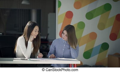 Asians and Europeans at the table to discuss the project on...