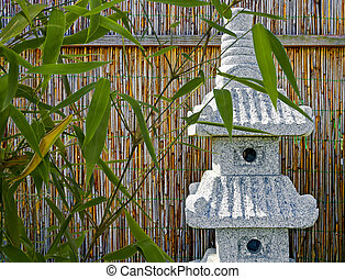 asiatic garden with bamboo and stone sculpture shaped like a...