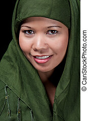 Asiatic islamic woman smiling - Portrait of asiatic woman of...