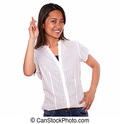 Asiatic smiling young woman crossing the fingers