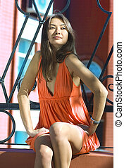 Asiatic woman - beautiful woman in bright colour dress...