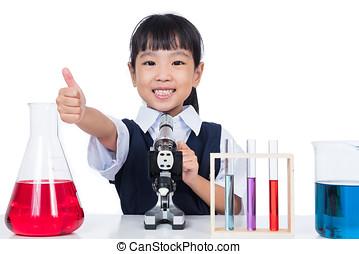 Junge mikroskop arbeitende chinesisches asiatisch junge