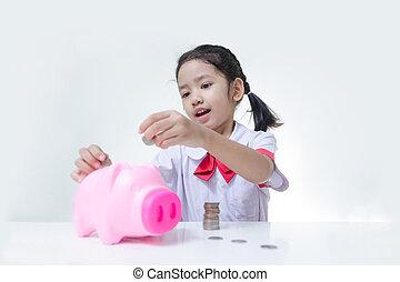 asiatisch, kleines mädchen, in, thailändisch, schueler, uniform, setzen, geldmünzen, zu, spaardose, vorgewählter fokus, auf, gesicht, seicht, schärfentiefe