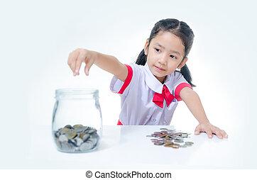 asiatisch, kleines mädchen, in, thailändisch, schueler, uniform, setzen, muenze, zu, glasglas, fokus, auf, gesicht, seicht, schärfentiefe