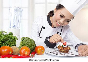 asiatische frau, küchenchef, garnishing