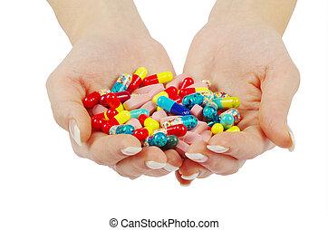 asideros, píldoras, manos