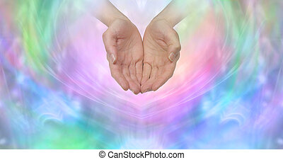 Female cupped hands emerging from a wispy pastel colored background with plenty of copy space ideal for a fundraising campaign