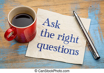 Ask the right questions - handwriting on a napkin with a cup...