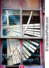 Askew Window Blind on Abandoned Building