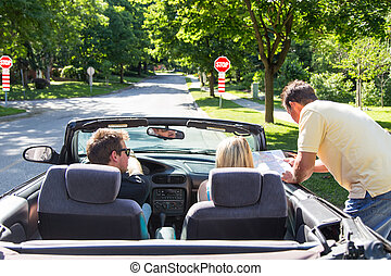Asking for directions - A young couple in a convertible...