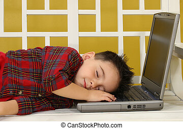 Asleep at Work - Adorable toddler boy asleep on his laptop.