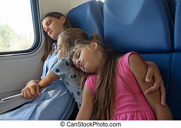 Asleep mom and daughters fell asleep in an electric train car